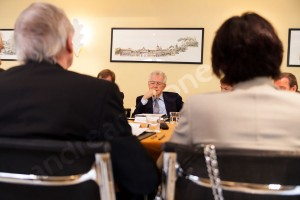 Prime minister sitting down during a meeting discussion photographed in Rome