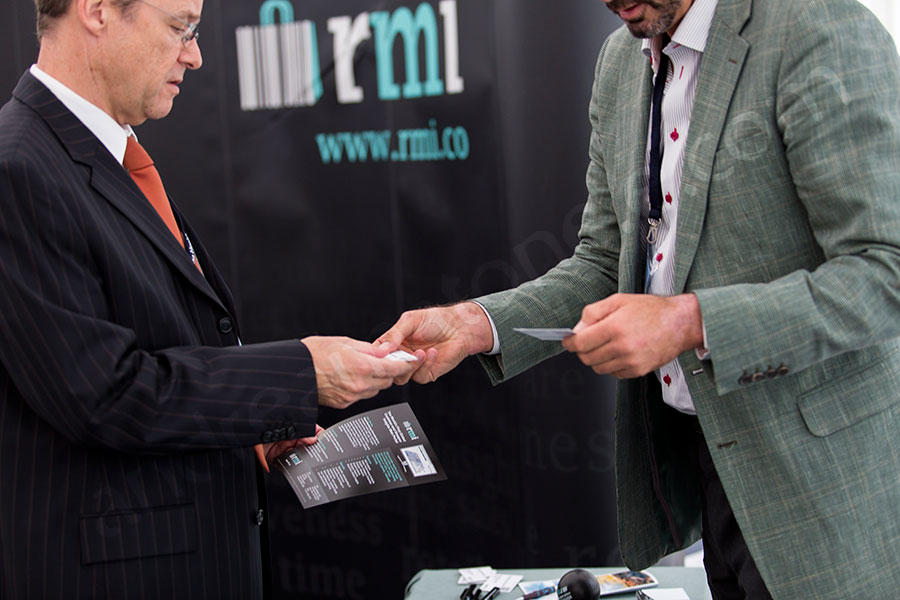 Business card exchange during a conference in Rome Italy