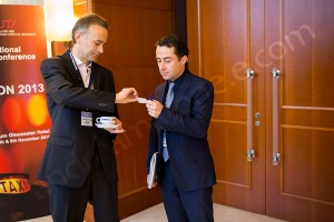 Exchanging business cards during break