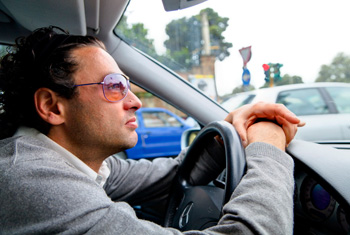 Car driver driving in Rome Italy