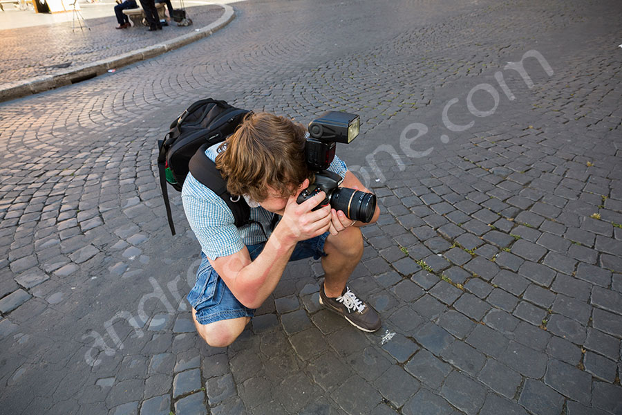 Photographer taking a picture during a photo tour in Rome
