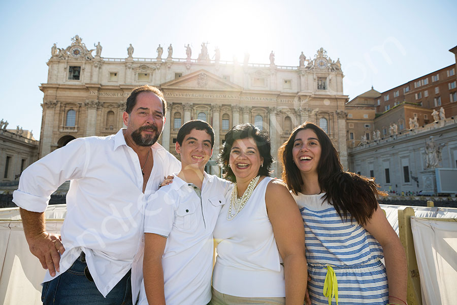 Family picture in front of Saint Peter's basilica in Rome Italy