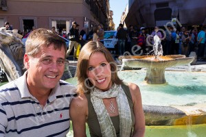 Couple photographed at the fountain in the Spanish steps in Rome