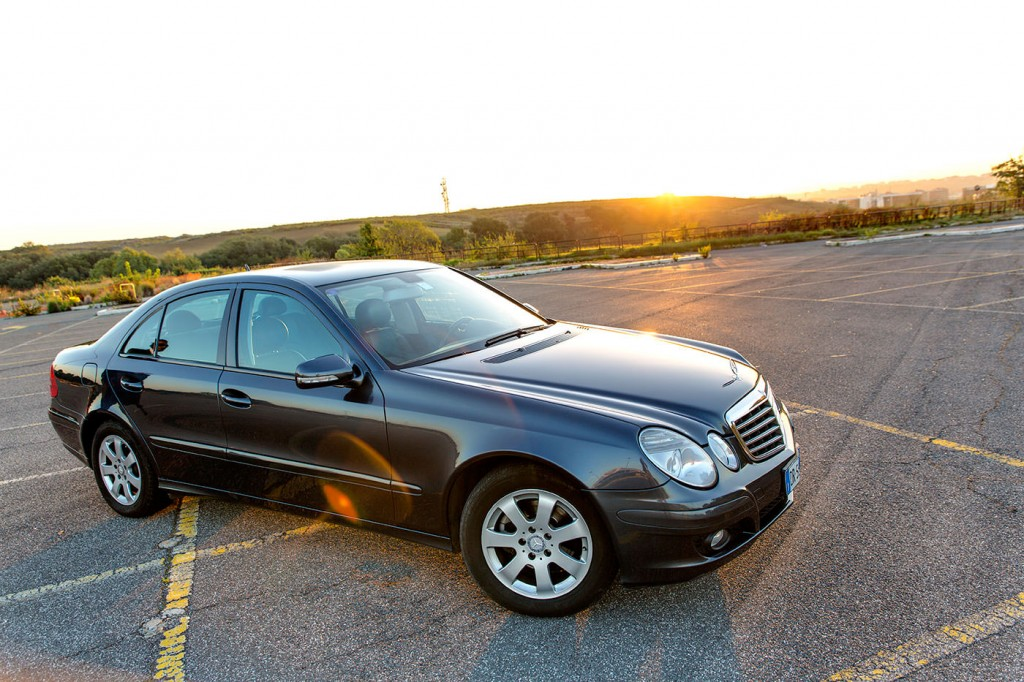 Mercedes E Class sedan at sunset