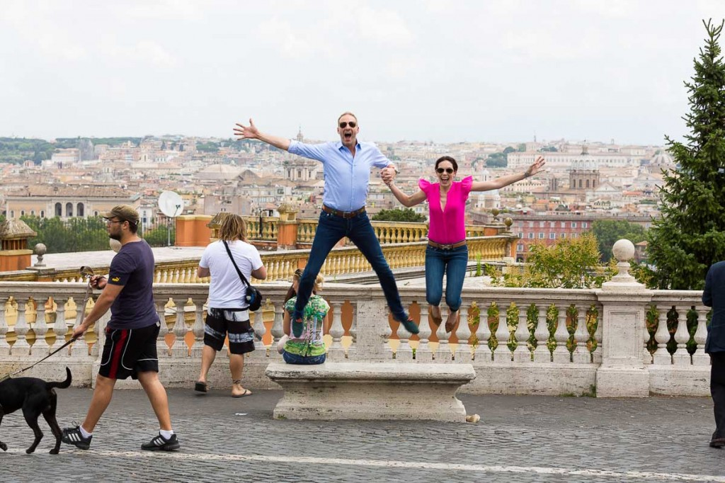 Jumping in the air at Gianicolo over the view of Rome during a photo tour