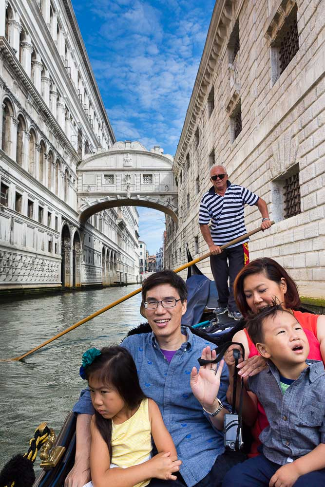 Venice Photo Tours. Riding on a gondola boat through the canals. Italy.