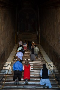 Holy stair. People climbing on the their knees. Scala Santa.