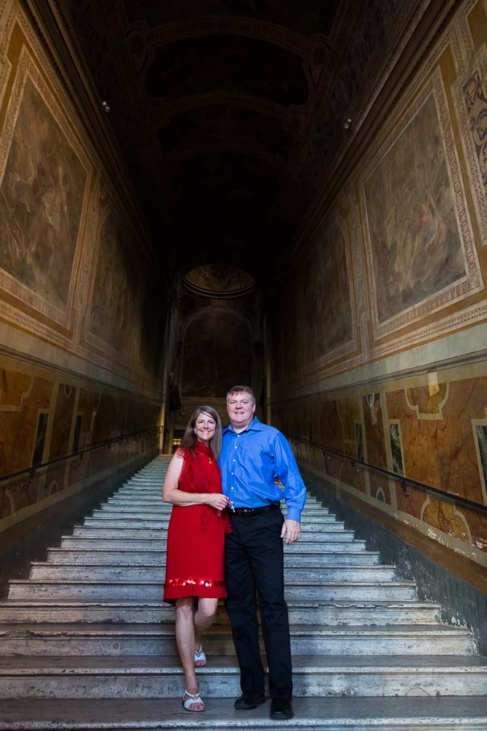 Couple standing on the side steps of the Scala Santa