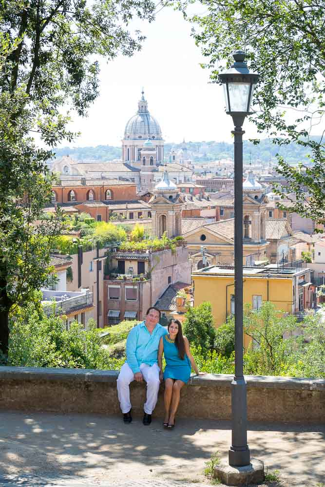Couple sitting down during a photo session in the city of Rome Italy