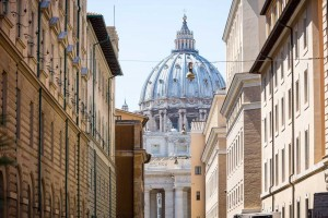View over Saint Peter's Basilica in Rome taken from a side street
