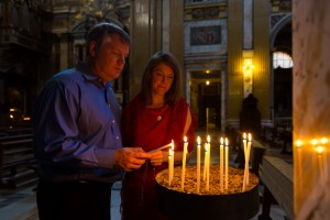 Church of Jesus inside. Lighting up candles.