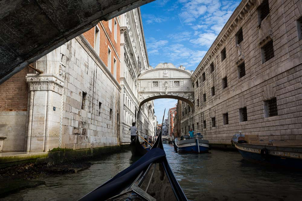 Gondola ride navigating underneath Ponte dei Sospiri in Venice