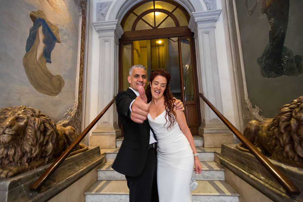 Bride and groom exiting the apartment building after the preparations. Planning a wedding in Rome.