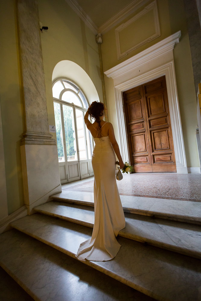 Bridal portrait. Picture taken from behind with the dress on the stairs.