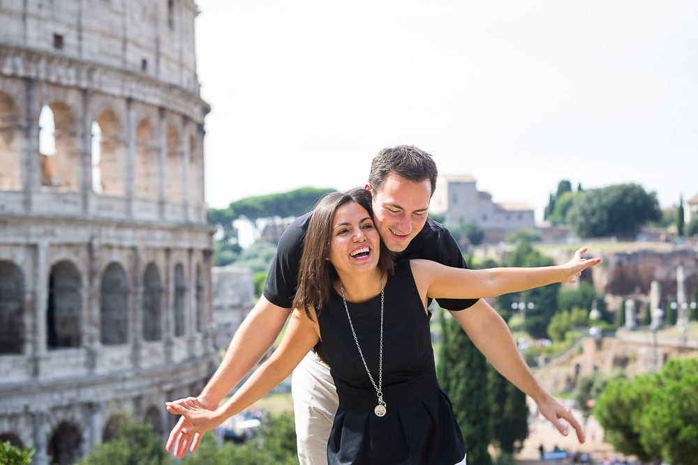 Having fun and enjoying the view over the Colosseum. Rome vacation photographer.
