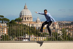 Jumping up in the air with Saint Peter's cathedral in the background