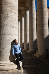 Man posing while leaning on a column