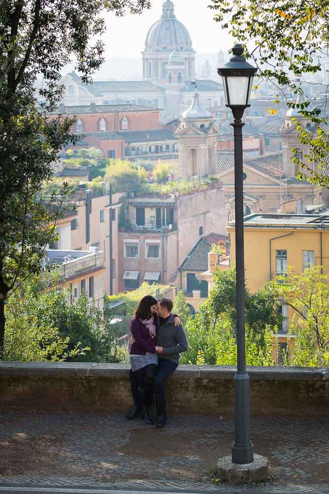 Couple together in love in Rome. Parco del Pincio. Villa Borghese.