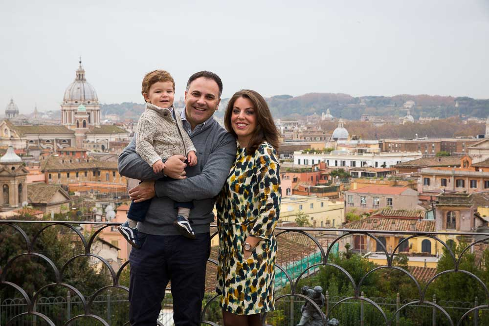 Family group photo with Rome as background