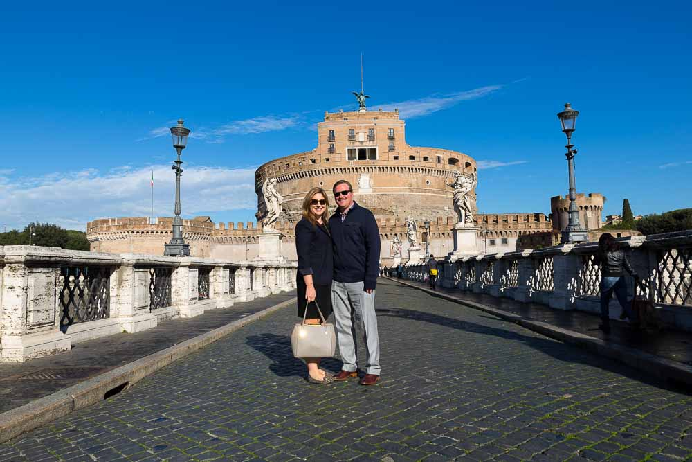 Standing on top of Castel Sant'Angelo bridge during a photo tour