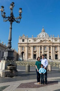 Family standing together before Saint Peter's Cathedral in the Vatican