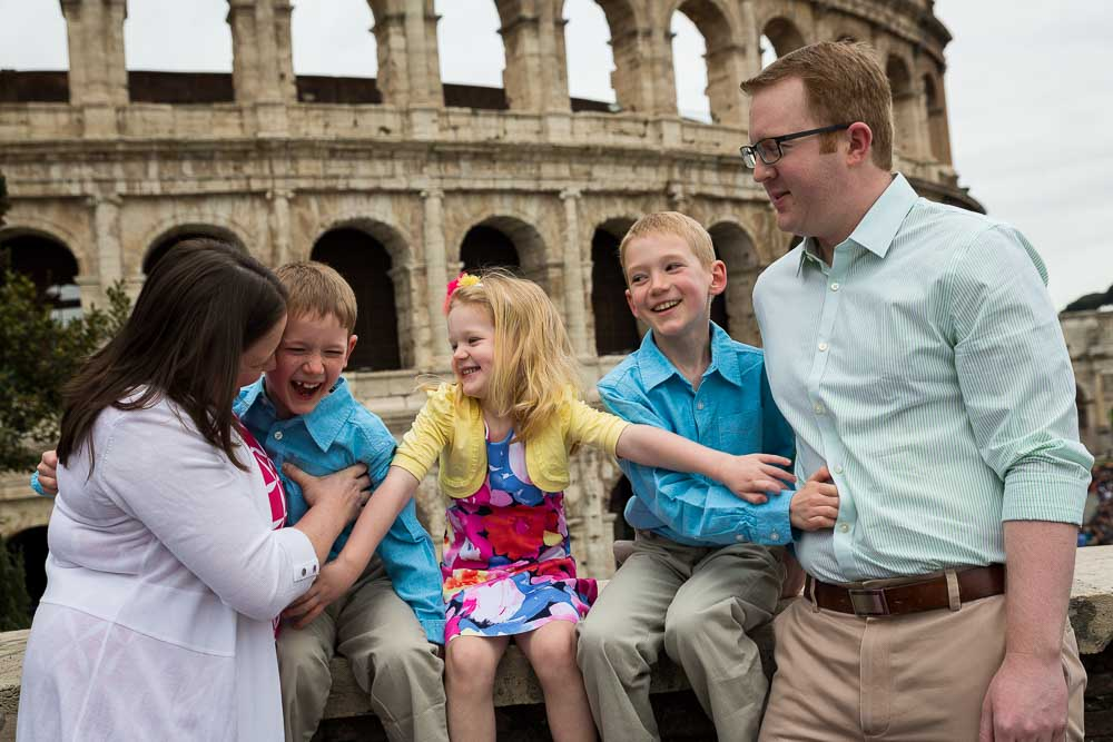 Family photo shoot in Rome by the Roman Colosseum