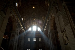 Light shining in through the window of San Pietro [Peter's] Basilica in Rome Italy in the Vatican