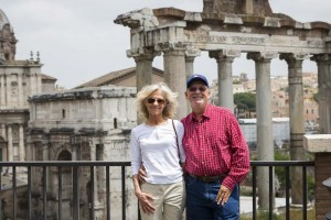 Couple visiting the roman forum smiling for the camera