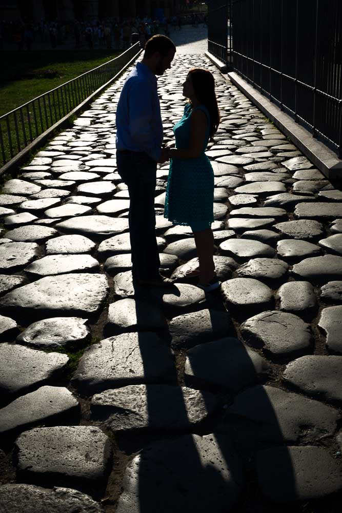 Couple silhouette image standing on an ancient roman road