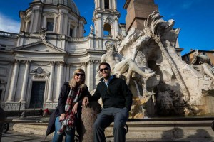 Couple sitting down having their picture taken in Piazza Navona