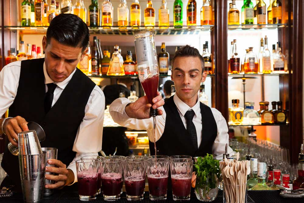 Bar tender preparing drinks for a party