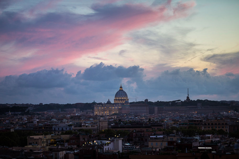Travel photography of Rome Italy seen from above at sunset. Rooftop view. Panoramic and scenic view.
