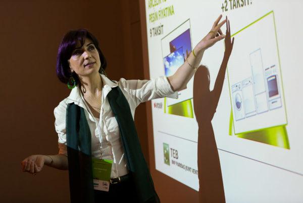 Speaker explaining concepts on screen
