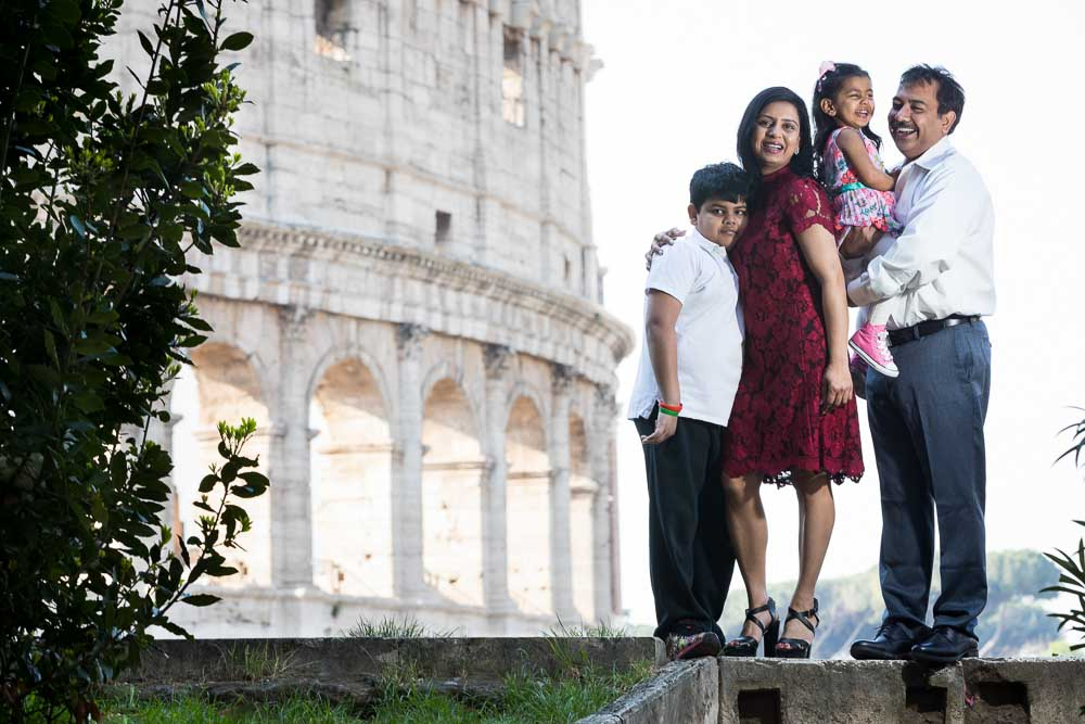Portrait picture of a family at the Roman Coliseum