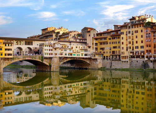 Image view of the Ponte Vecchio bridge water reflection over the Arno river