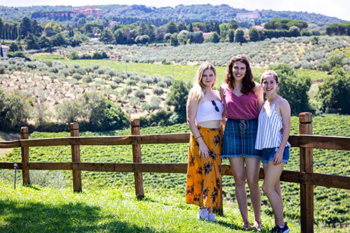 Guests posing for a group picture before the castelli romani vineyard countryside in around the town of Frascati Italy at a Frescati wine tour